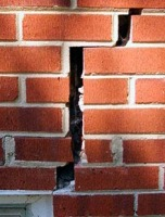 Cushing cracks in brick foundation repair